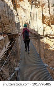 Woman crossing a suspended bridge in the Caminito del Rey gorge