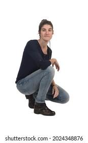 woman crouching on white background
