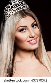 woman in crown on dark background