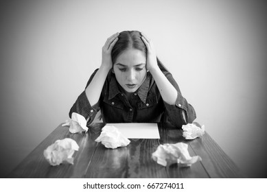 Woman crying over a blank sheet