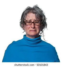 Woman crying tears, visibly upset and sad