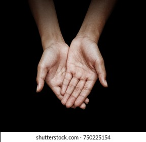 woman cupped hand in black background with clipping path