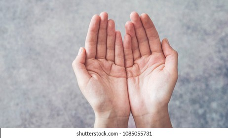 Woman cupped hands holding something