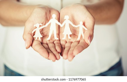 Woman cupped hands showing family