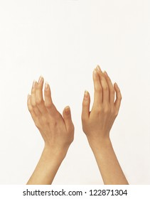 A woman cupping her palms in the air