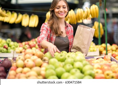 woman customer buying apple on the market