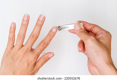 woman cut fingernail with herself.