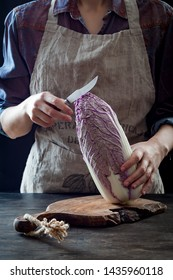 Woman cutting purple cabbage for kimchi recipe. Fermented and vegetarian probiotic food for gut health