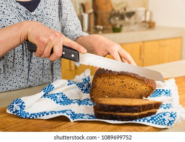 Woman cutting slices of gluten-free bread