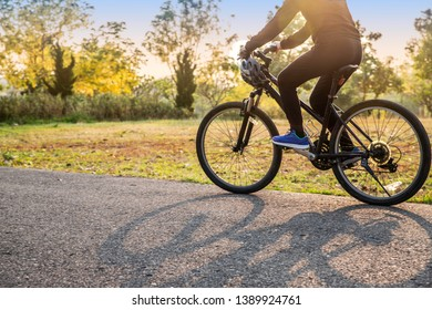 woman is cycling into the sunset in the park.  lifestyle, healthy concept - Image
