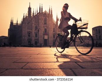 Woman cycling in Milan