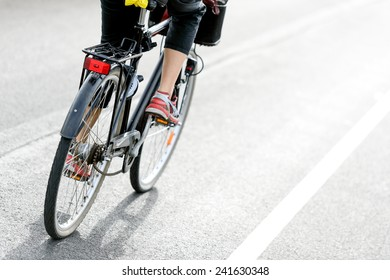 Woman cycling to work