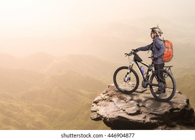 Woman cyclist on the top of the hill