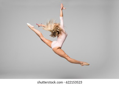 Woman dancer jump posing on isolated white background