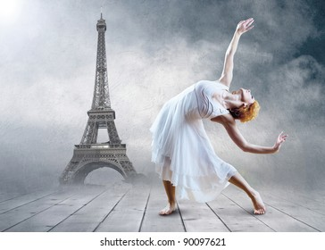 Woman dancer seating posing on the Eifel tower background