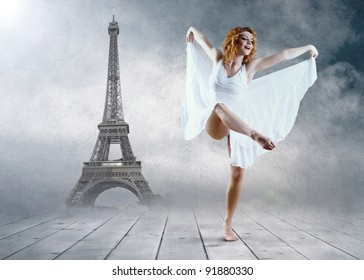 Woman dancer seating posing on the Eiffel tower background