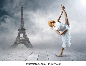 Woman dancer stay posing on the Eiffel tower background