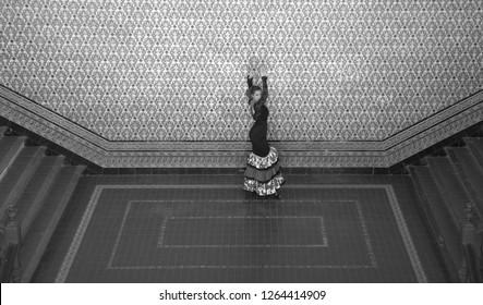 the woman dances the flamenco near the stairs