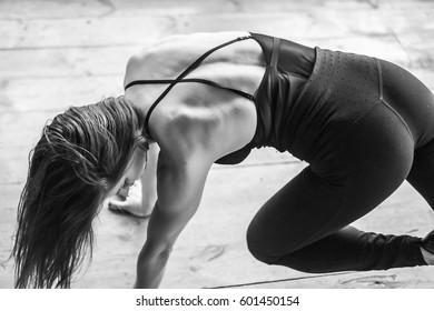 Woman dances strip plastic in class