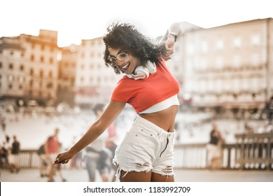 Woman dancing in the city in summer.