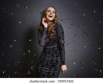 Woman dancing with falling confetti