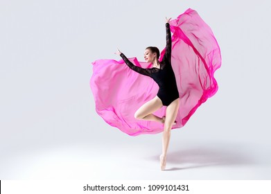 Woman dancing with flying cloth fabric, Ballet dancer in sport leotard, Flexible Gymnast Posing on White background