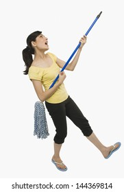 Woman dancing with a mop