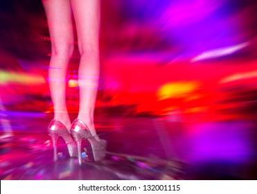 Woman dancing in the nightclub.