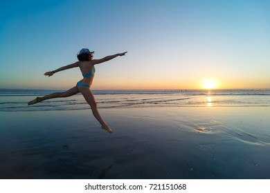 woman dancing on the beach, in low tide, inspiration. Bali, Indonesia