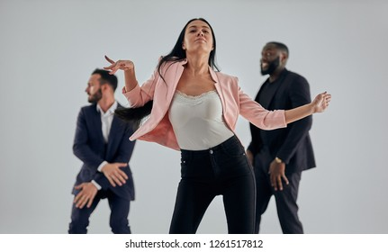 The woman dancing on the men background