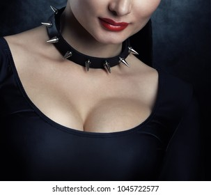 Woman in dark dress with collar