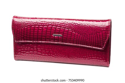 Woman dark pink leather purse isolated on the white background