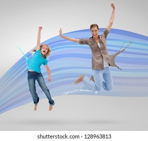Woman and daughter jumping with clothes turning to paint splatters on blue wave background