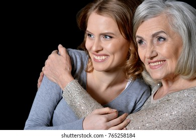 woman with daughter posing