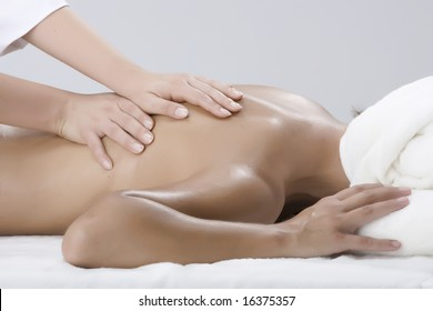 Woman in a day spa getting a deep tissue massage therapy
