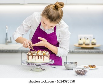 woman decorating chocolate cake in the kitchen