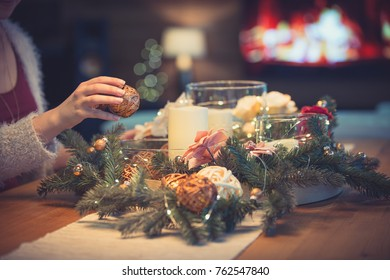 Woman decorating christmas table with bubbles