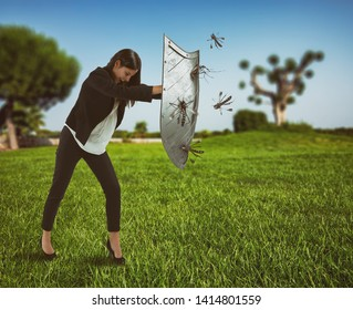 Woman defends herself from the attack of mosquitoes with a shield