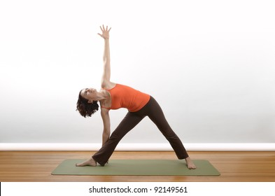 A woman demonstrates the Triangle position in yoga.