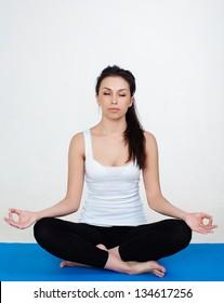 Woman demonstrating Sukhasana or Easy yoga pose