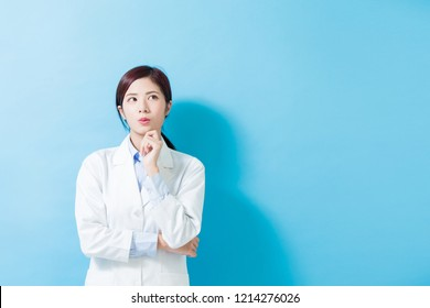 woman dentist serious look somewhere on the blue background