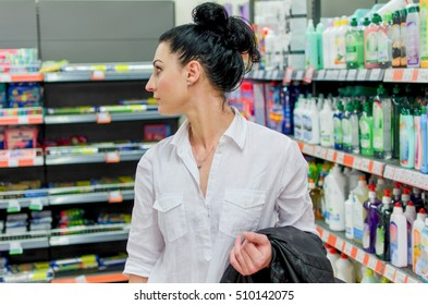 Woman in the department of home appliances in a supermarket
