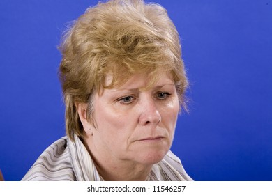 woman in a depressed state of mind on blue background