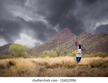 Woman in the Desert During a Rain Storm