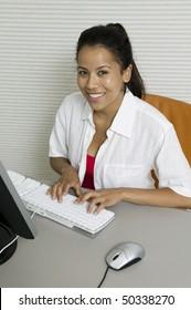 Woman at desk Using Computer, portrait