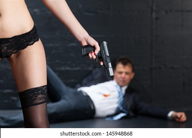 woman in dessous and a gun
