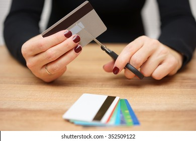 woman is destroying  credit cards because of big debt