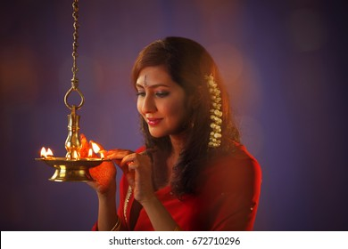 woman devotee lights  lamps as she celebrate 'Festival of Lights,