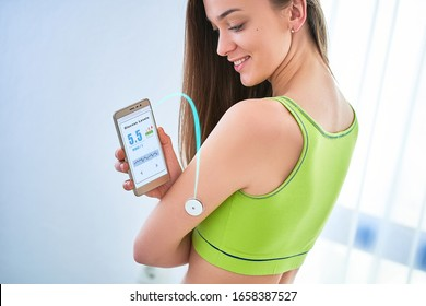 Woman diabetics control and checking glucose level with a remote sensor and smartphone. Monitoring glucose levels without blood. Digital medical technology in diabetes treatment, health care