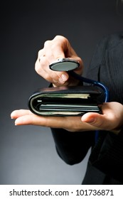 Woman diagnoses purse full of money and plastic cards (medical business background - medical insurance)